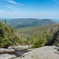 First views high on the Ammonoosuc Ravine Trail.- Lakes of the Clouds Hut + Mount Washington