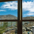 View from the Lakes of the Clouds Hut dining room.- Lakes of the Clouds Hut + Mount Washington