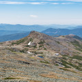 Mount Monroe and Lakes of the Clouds Hut from below the summit of Mount Washington.- Lakes of the Clouds Hut + Mount Washington