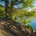 One of the most scenic parts of the trail along Mascoma Lake.- Northern Recreational Rail Trail