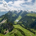 The view west from Hoher Kasten, including the Samtisersee Lake in the valley.- Alpstein Geological Path