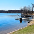The swimming beach and a small boat dock.- Beers Lake