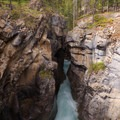The Siffleur River pours through a narrow slot just below the falls.- Siffleur Falls