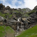 A waterfall totaling over 250 meters tall, seen from Oberbärgli.- Oeschinensee + Heuberg Loop
