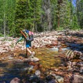 Crossing the East Fork of Rock Creek.- Squaw + Cleveland Peaks