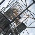 Looking up the tower's platforms and steps.- Pillsbury Mountain Fire Tower