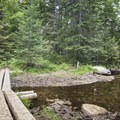 A larger wooden bridge over a stream.- Snowy Mountain Fire Tower