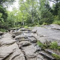Smooth rock faces and bedrock are part of the trail.- Snowy Mountain Fire Tower