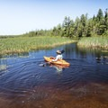 Paddling off through the marsh area at the southern end.- Deer River Flow