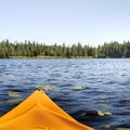 Kayaking across the water.- Deer River Flow