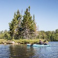Paddling by a small island at the northern end of the flow.- Deer River Flow