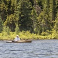 Another kayak paddler on the water.- Deer River Flow