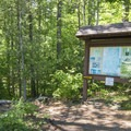 An information kiosk at the trailhead.- Poke-O-Moonshine Fire Tower