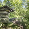 A lean-to at the trail intersection.- Poke-O-Moonshine Fire Tower