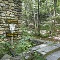 The former ranger cabin foundation.- Poke-O-Moonshine Fire Tower