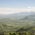View to the north from the fire tower.- Poke-O-Moonshine Fire Tower