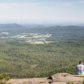 A scenic vantage-point over a rock ledge at the summit.- Poke-O-Moonshine Fire Tower