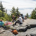 A small group breaking for lunch at the summit.- Pharoah Mountain