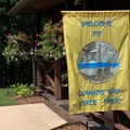 A welcome flag greets visitors at the park office.- Cowans Gap State Park