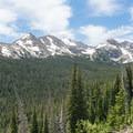 Jasper Peak and Mount Neva dominate the skyline ahead.- South Arapaho Peak
