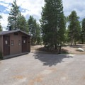 Vault toilets at Sunset Point Campground.- Sunset Point Campground