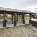 Picnic shelter and food storage vaults at Cutthroat Group Campground.- Cutthroat Group Campground