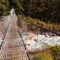 One of the many bridges crossing the Dudh Kosi river along the trek to Everest Base Camp.- Everest Base Camp (EBC) Overview