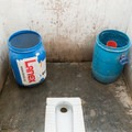 High altitude toilets are often frozen solid. Same goes for the rinse buckets and floors!- Everest Base Camp (EBC) Part II