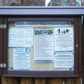 Signs marking historical and general events taking place on the park grounds.- Mormon Station State Historic Park