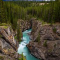 Long exposure capturing the vibrant Siffleur River and its surrounding impressive geology as well as the peaks above to the south.- Siffleur Falls