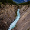 Long exposure capturing the vibrant Siffleur River and its surrounding impressive geology as well as the peaks above to the north.- Siffleur Falls