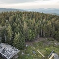 The observer's cabin in the clearing below.- Pillsbury Mountain Fire Tower
