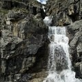 A series of waterfalls are visible as the hiking trail scrambles above the first lake. - Flower Springs Trail
