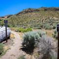 A couple of small signs mark the trail.- Deadman's Creek