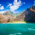 Boat tours are some of the best ways to see the dramatic cliffs of the Nā Pali coastline, bringing guests right up alongside pristine beaches and coves.- Nā Pali Coastal Tours