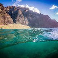 Snorkeling with the view of the massive cliffs is a once-in-a-lifetime opportunity!- Nā Pali Coastal Tours