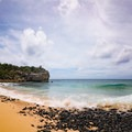 The beach is studded with large rocks that roll around in the surf.- Shipwreck's Beach