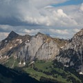 Bockmattlistock's recognizable cliffs are visible from Gross Aubrig's summit. Schiberg is visible to the right.- Gross Aubrig + Nussen Loop