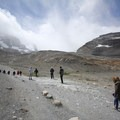 Many hikers traverse the rocky terrain on the short trail to the toe of Athabasca Glacier.- Athabasca Glacier