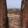 View through an embrasure on the rooftop of San Cristobal.- San Juan National Historic Park