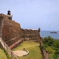 The lighthouse atop the impressive walls of San Felipe del Morro.- San Juan National Historic Park