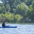 A paddler enjoys the view on the Big Sable River.- Big Sable River