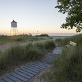 Looking out next to the Big Sable Lighthouse at sunset.- Ludington State Park Hiking Trails
