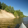 Desperation Point offers a sandy bottom swimming area.- Ludington Canoe Trail
