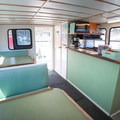 Onboard indoor seating. A drink and snack bar is available during the excursions.- Santa Cruz Whale Watching