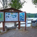 Interpretive signs at the park store parking area. From here, continue up the park road to return to the Glen Corrie Picnic Area.- Highland Loop