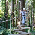 A swinging plank bridge is one of the challenging elements on the Sequoia Aerial Adventure course.- Mount Hermon Aerial + Zipline Adventures