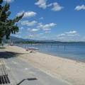 Big sandy beaches stretch around the park at Sandpoint City Beach Park. - Sandpoint City Beach Park