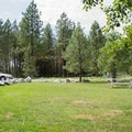 Parking area and picnic tables at the trailhead.- Mickinnick Trail