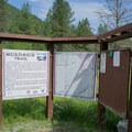 Information sign at the trailhead for the Mickinnick Trail. - Mickinnick Trail